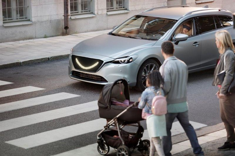 A smile tells pedestrians the car is aware of them