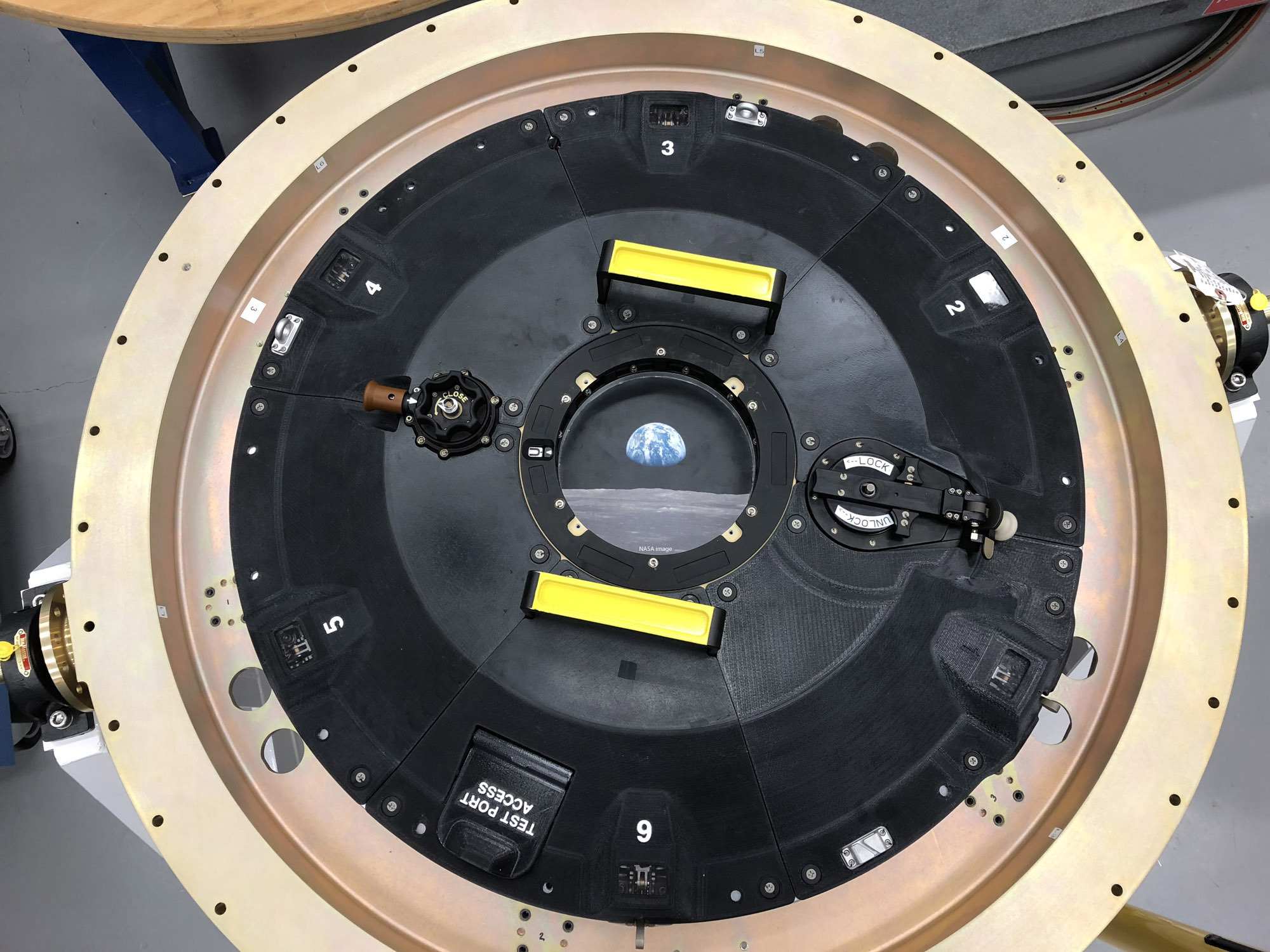 Orion spacecraft intricately-connected 3D printed docking hatch door