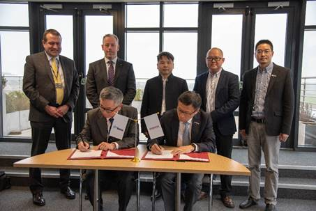 Electric vehicle development agreement signing