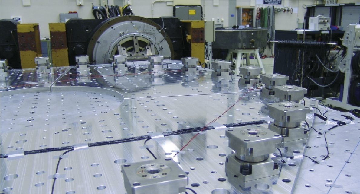 Spacecraft payloads undergo extreme vertical and horizontal vibration testing