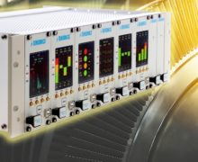 Monitoring system for rotating machinery takes input from displacement and vibration sensors