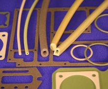 Elastomeric gaskets can be used with grooved surfaces to form a seal