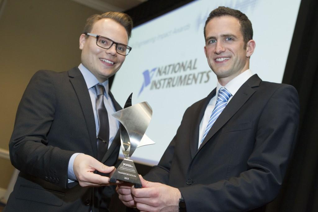 Balazs Pal and Toby Schulz receive the NI week Engineering Impact Award