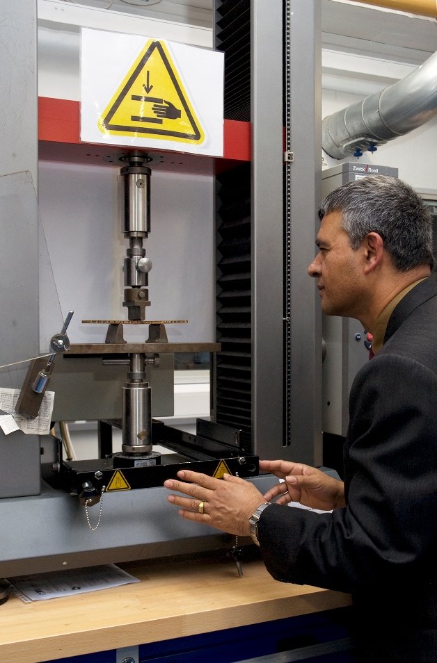 Dr Hom Nath Dhakal with a three point bend testing machine