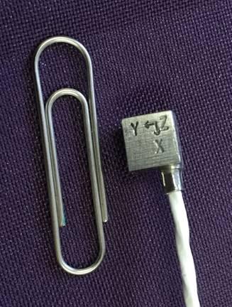 Miniature triaxial accelerometer